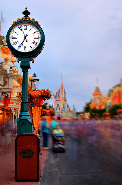 The clock on Main Street with Cinderella Castle in the background