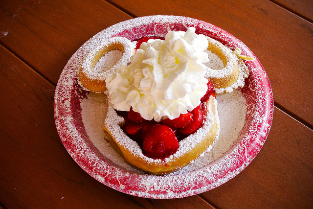 A Mickey Waffle with strawberries and cream