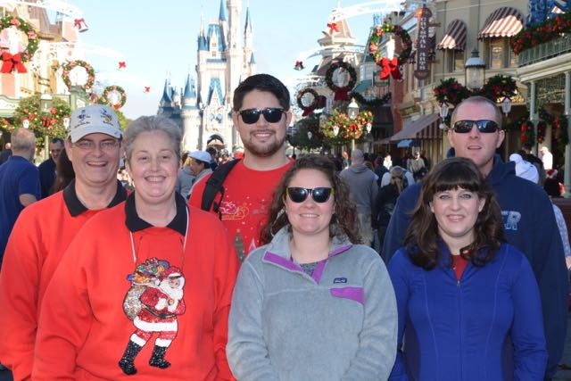 Dad and the family on Main Street in the Magic Kingdom