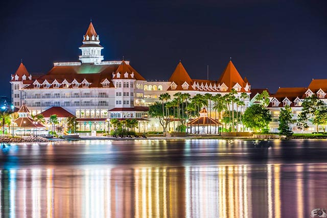 the lights from the Grand Floridian reflecting off the water at night